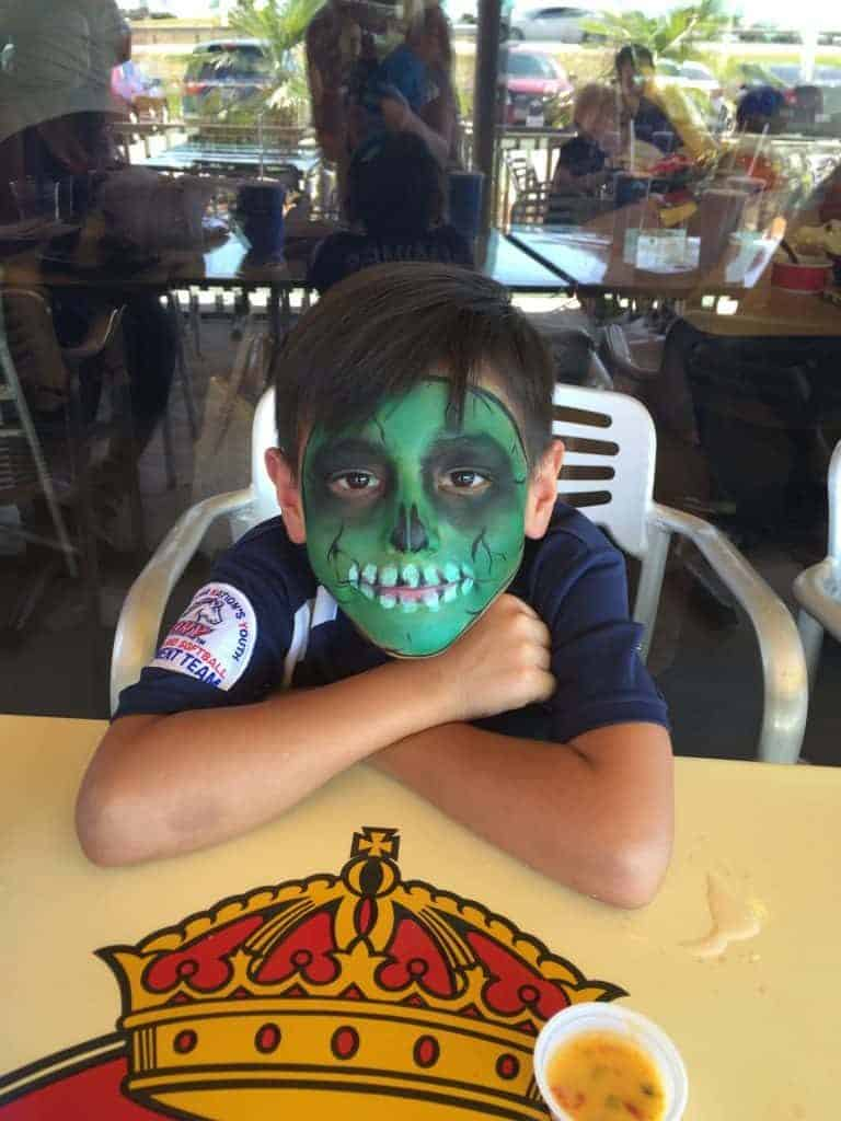 face-painting-kid-taco-cabana-kyle-texas-grand-opening-fiesta-768x1024-2083591